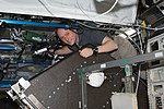ISS-18 Michael Fincke performs a leak check on the Water Recovery System in the Destiny lab.jpg