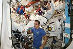 ISS-53 EVA-2 Joseph Acaba assisted crewmates inside the Quest airlock.jpg