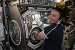 ISS-56 Serena Auñón-Chancellor works with the glovebox inside the Destiny lab.jpg