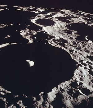 Icarus (crater) - Oblique view of Icarus, facing south, from Apollo 11.  Note that the central peak of the crater is illuminated, demonstrating that it is higher than the rim.