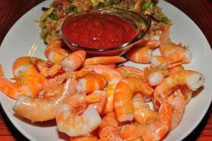 Ice cold shrimp and cocktail sauce (4847681860).jpg