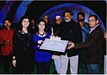 Ila and Ibra Khalid being awarded with a cert. and cash.jpg