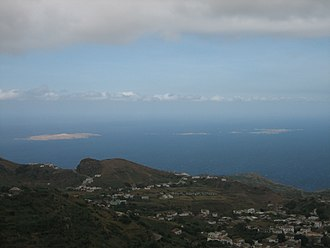 Brava, Cape Verde - The uninhabited islets Ilhéus Secos or Ilhéus do Rombo with parts of the town of Nova Sintra.