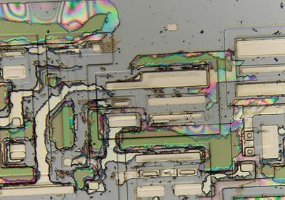 Incomplete etching of the last glass layers on an integrated circuit die.
