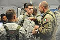 Italian army Capt. Alberto Valent, right foreground, speaks with U.S. Army Capt. Austin Maples, center, with Headquarters and Headquarters Troop, 2nd Cavalry Regiment, during a decisive action training 121027-A-GM460-007.jpg