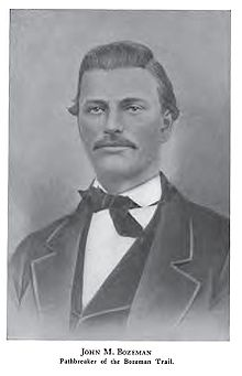 B&W image of a man with oiled hair and a wide moustache