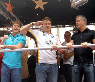 Paddick on a float at the London Gay Pride parade on 30 June 2007 with, from his right, actor John Barrowman and Barrowman's partner Scott Gill John Barrowman at London Gay Pride 2007.jpg