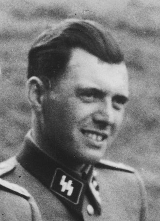 Josef Mengele - Pictured outside Auschwitz in 1944