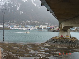 Juneau–Douglas Bridge - Photo taken below the bridge, facing east from Douglas Island, shows the bridge's superstructure and support column above Gastineau Channel
