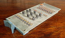 "A ""B"" (blue) series Flip Chip module containing nine transistors, 1971"