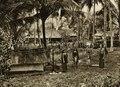 KITLV - 78477 - Kleingrothe, C.J. - Medan - Batak villagers at a grave in a village on the east coast of Sumatra - circa 1905.tif