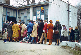 Family in the Soviet Union - Soviet people of mixed ages queuing to a Kharkov cinema. 1981.
