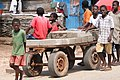 Kids Pulling a Cartload of Bricks - Elmina - Ghana (4721002709).jpg