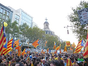 2012 Catalan independence demonstration - View of the demonstration running through Passeig de Gràcia in front of La Unión and el Fénix Building.