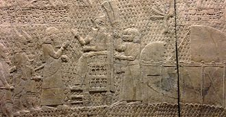 """Tel Lachish - The single inscription which identifies the location depicted in the reliefs reads: """"Sennacherib, the mighty king, king of the country of Assyria, sitting on the throne of judgment, before (or at the entrance of) the city of Lachish (Lakhisha). I give permission for its slaughter"""""""