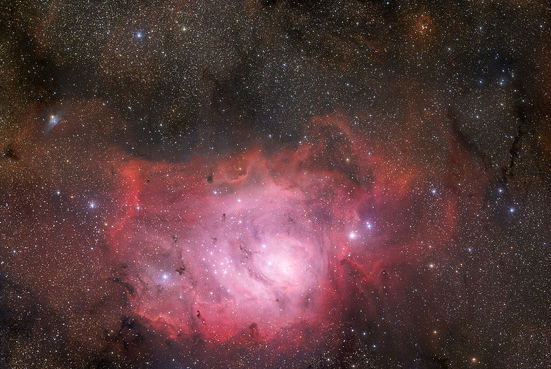 Lagoon nebula as it appears through a telescope in the night sky