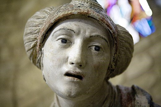 Holy Woman in a peasant's bonnet (L'eglise Saint-Didier, Clermont-en-Argonne) Ligier Richier 11.jpg