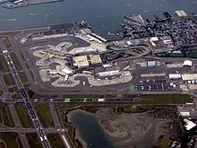 Aerial view of Logan Airport with Boston Harbor on the top of the image