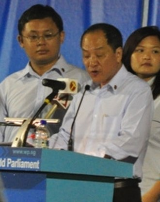 Low Thia Khiang - Low (centre) at a rally in Sengkang during the 2011 general election.