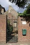 foto van Pastorie, tegen de Oude Kerk; bestaat ten dele uit baksteen met speklagen.