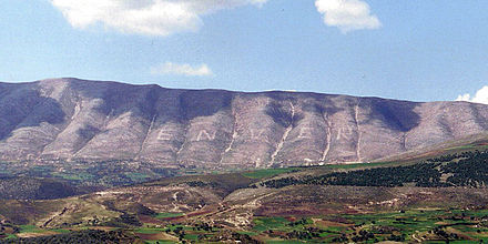 Mount Shpiragu as seen from Berat showing the name of Hoxha written on its side Mali i Shpiragut.jpg