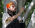 Man in a tree with cameras (2038455725).jpg