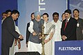 Manmohan Singh lighting the lamp to inaugurate the Flextronics Industrial Park at Sriperumbudur in Tamil Nadu. The Chairperson, UPA, Smt. Sonia Gandhi and the Union Minister for Communications and Information Technology.jpg