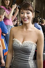 Mary Elizabeth Winstead, a Caucasian female, is wearing a gray dress and looking a few degrees sideways from the camera.