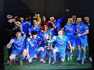 Matlock Town F.C. - Photo taken when Matlock Town won the Derbyshire Senior Cup in 2015. They beat Gresley FC 7-0 at Chesterfields' Proact Stadium. Holding the trophy are Adam Yates and Niall Mcmanus.