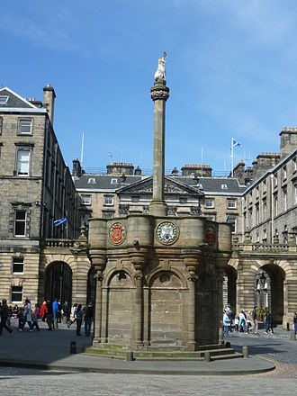 Mercat Cross, Edinburgh - The Mercat Cross viewed from within Parliament Square looking across the Royal Mile with the pediment of Edinburgh City Chambers in the background.