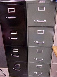 A tall metal filing cabinet for work or home use.