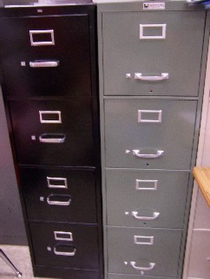 Filing cabinet - Two tall metal file cabinets for work or home use