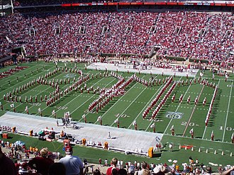 "Million Dollar Band (marching band) - The band performing a ""Booming Big Bama Spell Out"" before a football game"