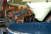 Missile Maintainer inspects missile guidance system of the LGM-30G Minuteman ICBM