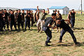 Mongolian General Police officers take part in a mechanical advantage control holds competition during Non-Lethal Weapons Executive Seminar (NOLES) 13 at the Five Hills Training Area in Mongolia Aug. 19, 2013 130819-M-DR618-023.jpg