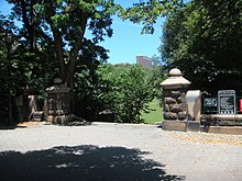 Two short stone columns signify the park's entrance.