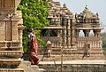 Mother and child entering Khajuraho temple. India.jpg
