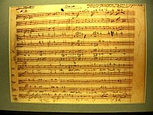 Facsimile sheet of music from the Dies Irae movement of the Requiem Mass in D minor (K. 626) in Mozart's handwriting (Mozarthaus, Vienna) (Source: Wikimedia)