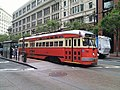 Muni 1059 at Market and 3rd, June 2011.jpg