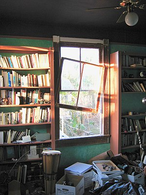 Lakeview, New Orleans - Upstairs library room in home where downstairs flooded Lakeview neighborhood. Hurricane winds blew out window, but left books in shelves