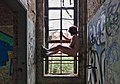 Naked man looking out the window of an abandoned military building in Fort de la Chartreuse, Liege, Belgium (DSCF3407).jpg