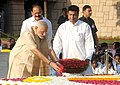 Narendra Modi paying floral tributes at the Samadhi of Mahatma Gandhi on his 146th birth anniversary, at Rajghat, in Delhi. The Union Minister for Urban Development.jpg