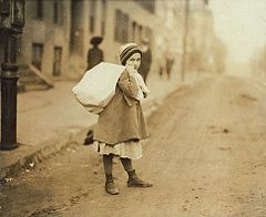 Nearly 9 A.M. Girl (about 8 yrs. old) carrying sack of hose supporters home.jpg