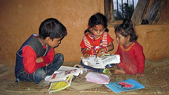 Human rights in Nepal - Nepalese Children secondhanded textbook at rural side in Nepal