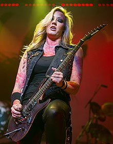 Nita Strauss of Alice Cooper performing in San Antonio, Texas 2015.jpg