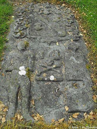 Archdeacon of Kells - Motif in old Nobber graveyard, male figure wearing a Mitre