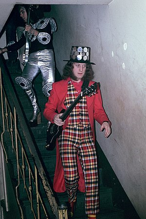 Slade - Noddy Holder (right) and Dave Hill (left), near the height of their fame in 1973, showing some of their more extreme glam rock fashions.