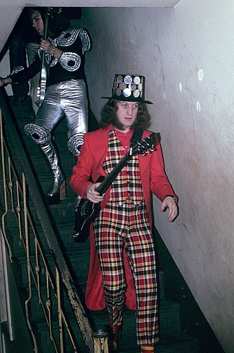 Noddy Holder (right) and Dave Hill (left) of Slade, near the height of their fame in 1973, showing some of the more extreme glam rock fashions Noddy Holder - Slade - 1973.jpg