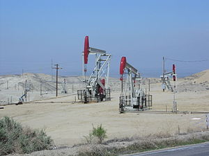 Elk Hills Oil Field - Three Occidental Petroleum active oil wells (using nodding donkeys); south of Buttonwillow, California