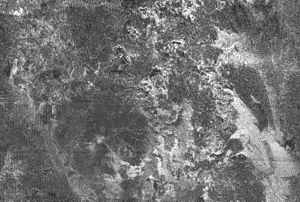 Macula (planetary geology) - The Ganesa Macula on Titan is the large circular spot in the lower left of this image which was thought to be an ice volcano.